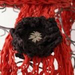 écharpe orange tricotée main